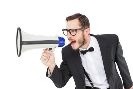 businessman using a megaphone: Geeky businessman shouting through megaphone on white background