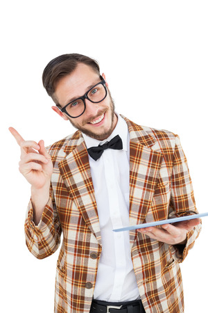 Geeky hipster holding a tablet pc on white background photo