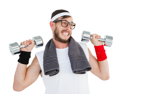 geeky: Geeky hipster lifting dumbbells in sportswear on white background Stock Photo