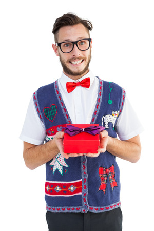 christmas time: Geeky hipster offering christmas gift on white background
