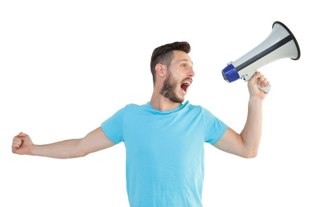 Handsome hipster talking through megaphone on white background photo