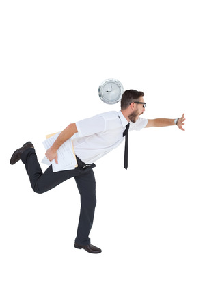 late 20s: Geeky young businessman running late on white background Stock Photo