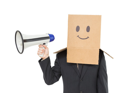 businessman using a megaphone: Businessman with box on head holding megaphone on white background