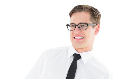 disapproving: Geeky giovane hipster, guardando con disgusto su sfondo bianco Archivio Fotografico