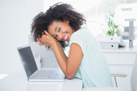 woman  laptop: Happy businesswoman taking a break at desk in her office