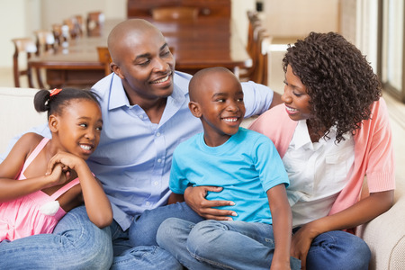 multiracial family: Family relaxing together on the sofa at home in the living room