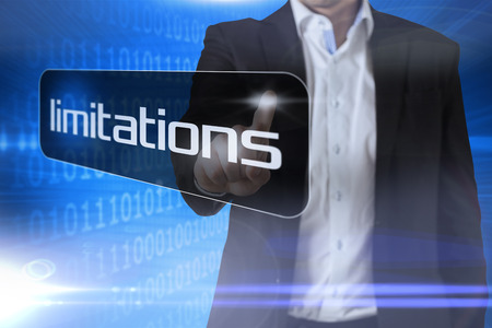 limitations: Businessman pointing to word limitations against futuristic shiny binary code