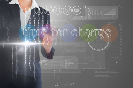 Businesswoman touching the words time for change on interface against grey vignette photo