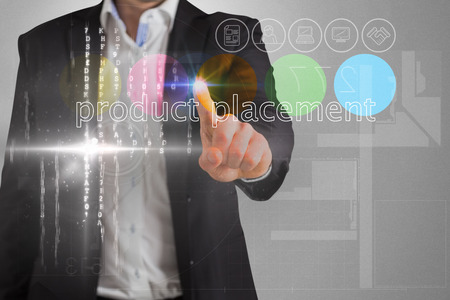 placement: Businessman touching the words product placement on interface against grey vignette