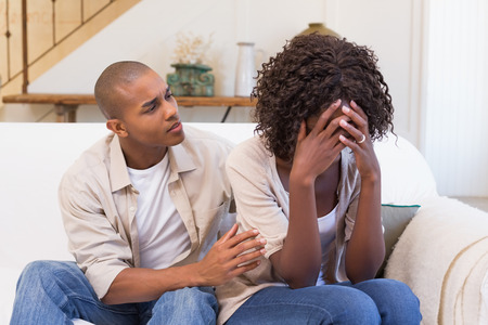 couple home: Crying woman not listening to his excuses at home in the living room