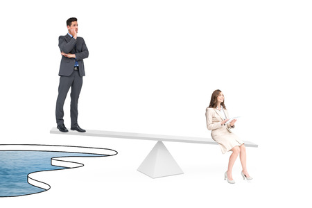 White scales measuring business people over pool of water photo