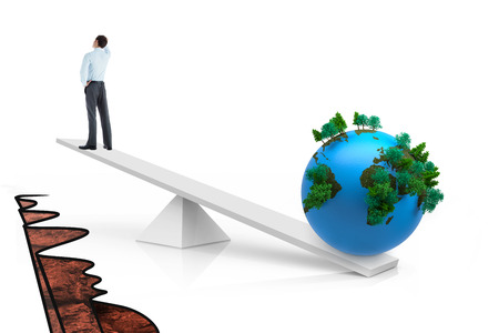 cliff edge: White scales weighing businessman and earth over cliff edge