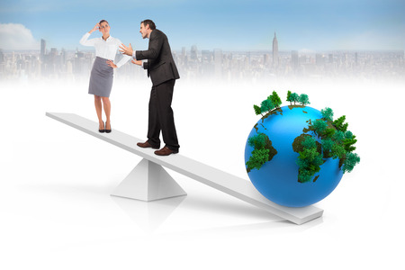 White scales weighing business people and earth with cityscape in background photo
