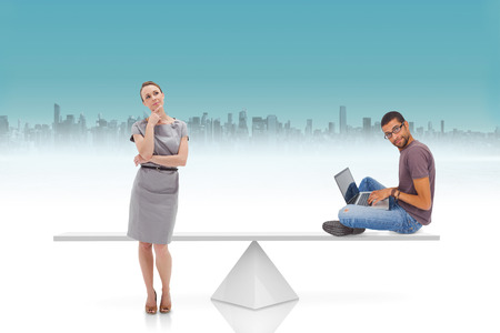 White scales weighing businesswoman and man against cityscape on horizon photo
