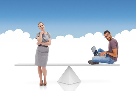 White scales weighing businesswoman and man against blue and white background photo