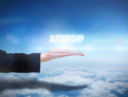 authorship: Businesswomans hand presenting the word authorship against blue sky over clouds at high altitude