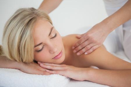 Pretty blonde enjoying a massage at the health spa photo