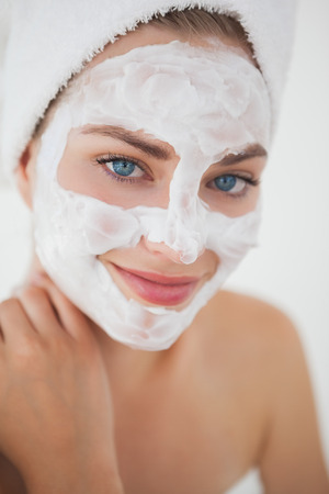 Beautiful blonde getting a facial treatment at the health spa Stock Photo