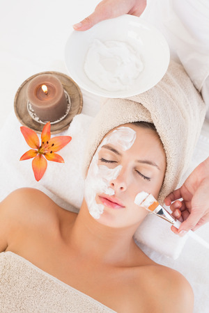 High angle view of an attractive young woman receiving treatment at spa center photo