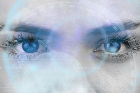 close up eyes: Composite image of close up of female blue eyes against triangle design Stock Photo