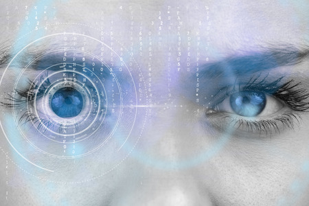 eyes close up: Composite image of close up of female blue eyes against interface Stock Photo