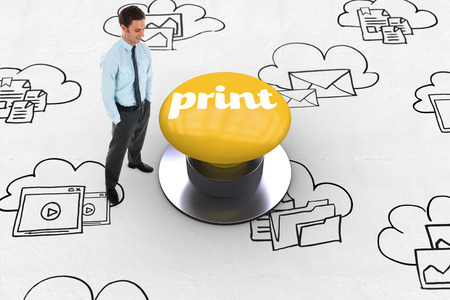 The word print and happy businessman standing with hands in pockets against yellow push button photo