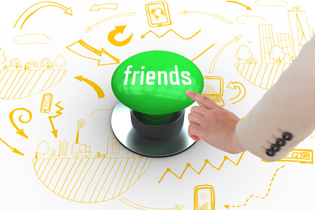 The word friends and businesswoman pointing against digitally generated green push button photo