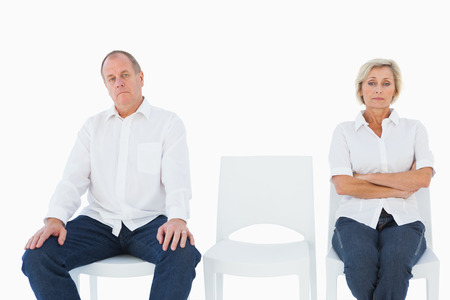 not talking: Upset couple not talking to each other after fight on white background Stock Photo
