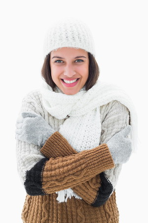Pretty brunette in warm clothes on white background photo