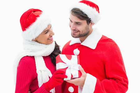 Attractive festive couple holding a gift on white background photo