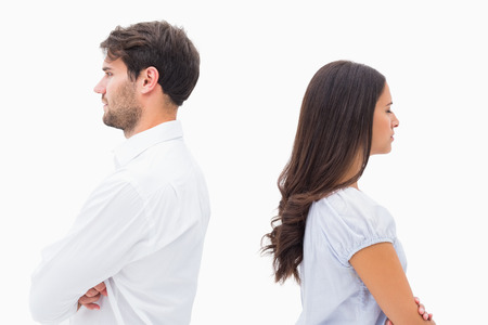 Upset couple not talking to each other after fight on white background Stock Photo