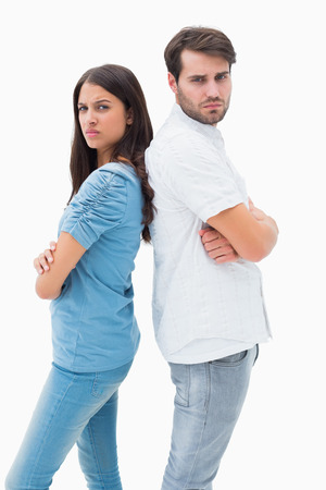 exasperated: Upset couple not talking to each other after fight on white background Stock Photo