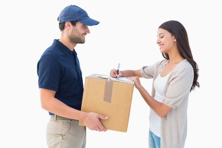 Happy delivery man with customer on white background Foto de archivo