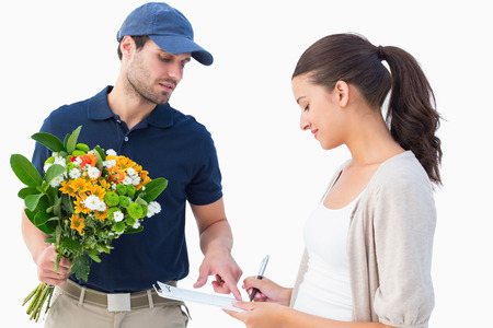 Happy flower delivery man with customer on white background photo