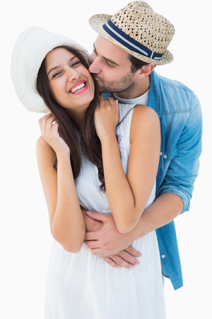 Happy hipster couple hugging and smiling on white background photo