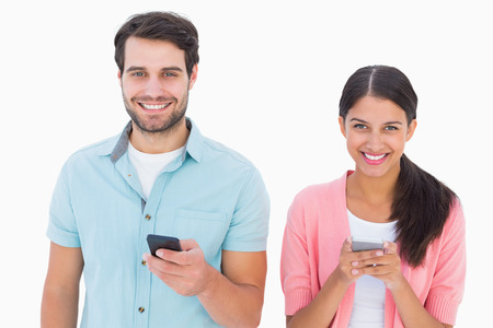 Happy couple sending text messages on white background Stock fotó