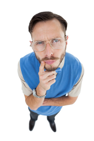 Geeky hipster looking at camera on white background photo