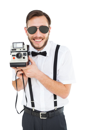 aviators: Geeky hipster holding a retro camera on white background