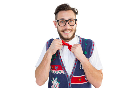 Geeky hipster wearing christmas vest on white background