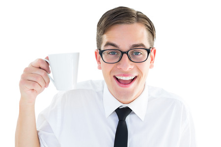 Geeky businessman holding a mug on white background photo