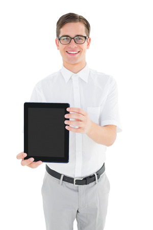 Geeky businessman showing his tablet pc on white background photo