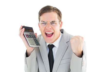 Geeky smiling businessman holding calculator on white background photo