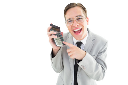 Geeky cheering businessman holding calculator on white background photo