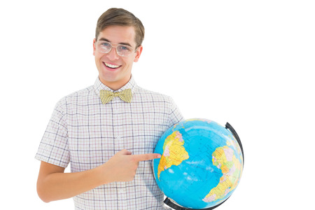 Geeky hipster holding a globe smiling at camera on white background Stock Photo