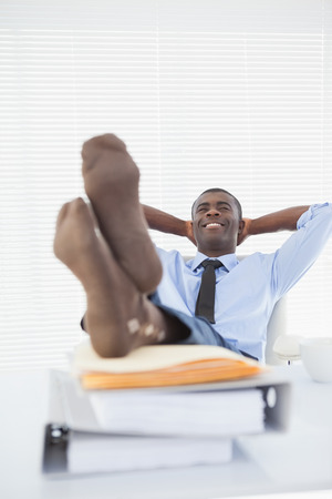 feet up: Relaxed businessman sitting in his chair with feet up in his office Stock Photo