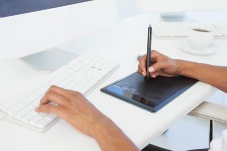 digitizer: Designer working at desk using digitizer in his office