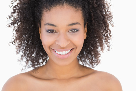 african american nude: Pretty girl with afro hairstyle smiling at camera on white background