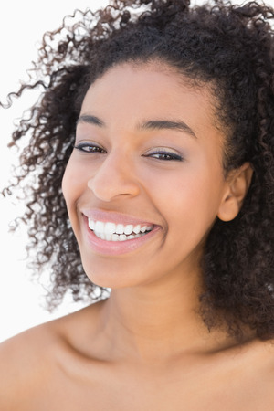 afro american nude: Pretty girl with afro hairstyle smiling at camera on white background