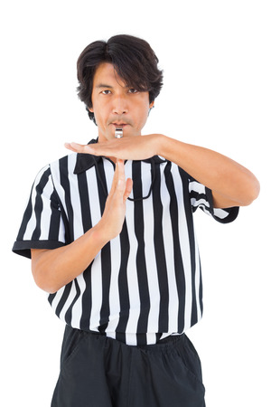 whistling: Stern referee showing time out sign on white background