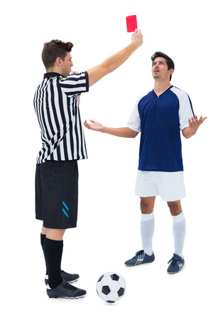 pleading: Referee sending off football player on white background